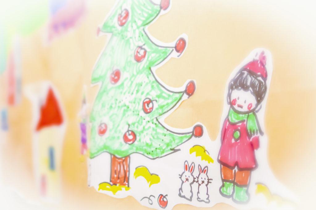 クリスマスツリーと子供のイラスト